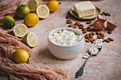 Baking ingredients: cottage cheese, lemons, almonds, ricotta