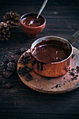 Melted dark chocolate in copper pot
