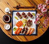 Sashimi and Nigiri sushi set on wooden table