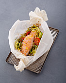 Herby salmon in a vegetable parcel