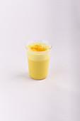 A glass of golden milk