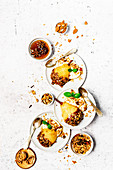 Poached pear with chocolate, granola and yoghurt
