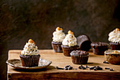 Chocolate muffins with white whipped butter cream and salted caramel