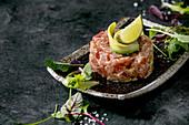 Tuna tartare with green salad, lime, avocado and mustard sauce