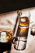 Whiskey with orange spirals and ice cubes