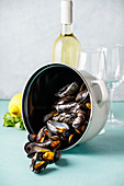 Pot of steamed mussels with lemon, herbs and white wine