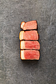 Steak in different cooking stages