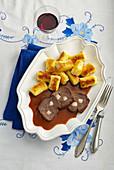 Roast wild boar with rose hip sauce and potato gnocchi