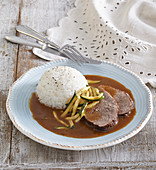 Roast beef with zucchini, rice and sauce