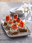 Salmon canapés with boiled egg and caviar