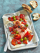 Salmon with baked red bell pepper, tomato and olives