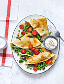 Pancakes with peas, green asparagus and caramelized tomatoes