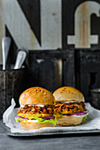 Pulled jack burger with lime mayonnaise, pineapple and red onions
