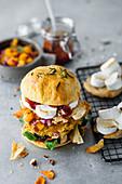 Turkey burger with pumpkin relish, marshmallows and whiskey BBQ sauce