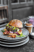 Wild boar burger with blueberry mayonnaise, bacon, pear and pointed cabbage