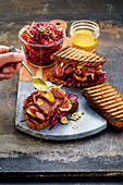 Grilled duck breast sandwich in 'pastrami style' with ruby red slaw