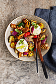 Grilled bread salad with burrata and halloumi