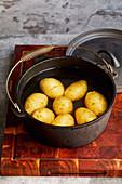 Preparing Hasselback potatoes