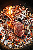 Grilling a flank steak 'caveman' style