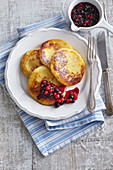 Potato pancakes with fruit coulis
