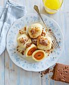 Apricot dumplings with pumpernickel bread