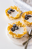 Chia pudding phyllo tartlets with blackberry and ruby chocolate