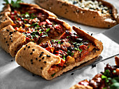 Pide with minced meat and spinach filling