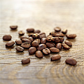 Coffee grains on wooden surface