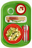 Green tray Italian theme with pasta , ham grissini and pannacota