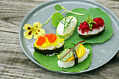 Homemade vegetarian Sushi with flowers, beetroot and herbs