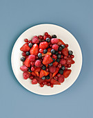 Red fruits in white plate