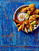 Crispy chicken with peanut dip and sweet potato wedges