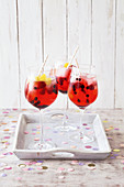 Pink Berry Cocktail with Lemonade, Blueberries and Raspberries