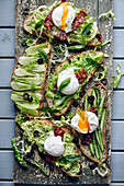 Healthy 'green' bread with a poached egg and crispy bacon