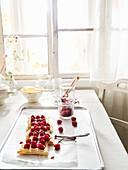 Puff pastry raspberry tart on kitchen table