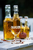 Apple juice in glass and swing-top bottles