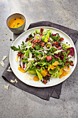 Leaf salads with pepper and lentil mix, sweet potatoes and parmesan