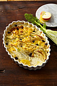 Potato and fennel casserole with apples and raisins