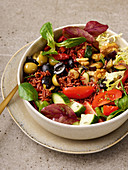 Mediterranean bowl with olives, eggplant, zucchini and cucumber