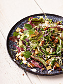 Sweet salad with parsnips, cranberries and hazelnuts