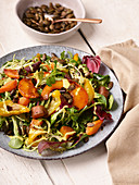 Autumn leaf salad with sweet potatoes, bell pepper and pumpkin seeds