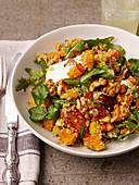 Warm mango and quinoa salad with walnuts
