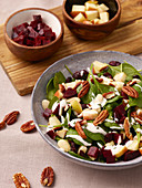 Vegan beetroot salad with apple, pecans and spinach