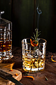Drink Old Fashioned with rosemary in tumbler glass