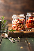 Rhubarb and strawberry crumble in glass