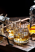 Whiskey on the rocks in glass tumbler