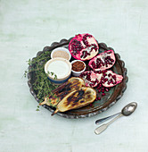 Roasted eggplant with pomegranate, cream, sesame, chili flakes and thyme