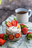 Lukewarm chia pudding in a glass with strawberries