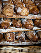 Baguettes stacked in a French Boulangerie dusted with flour