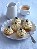 Tartlets with lemon and poppy seed cream